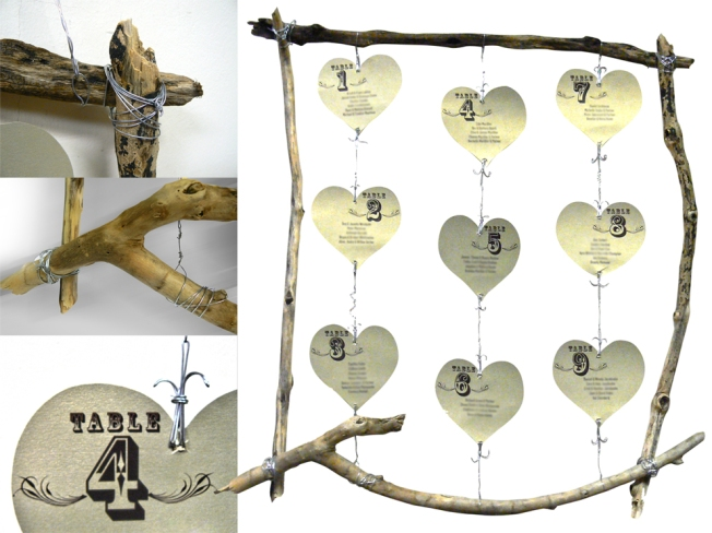 The table seating arrangement, made-up of driftwood found on the beach, names and table numbers printed on 'Gold Leaf' 250gsm card then cut into heart shapes and craft wire! All wrangled together with a little imagination, patience and two pairs of pliers is something completely unique to me (due to the fact that it was an idea I came up without any inspiration from anywhere or from seeing any pictures)